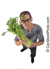 portrait of a man with celery on white background