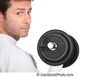 portrait of a man with dumbbell