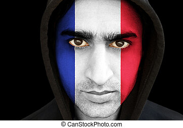 Portrait of a man with french flag