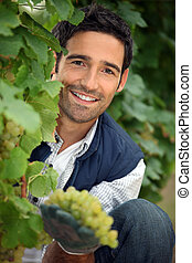 portrait of a man with grapes
