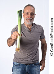 portrait of a man with leek on white background