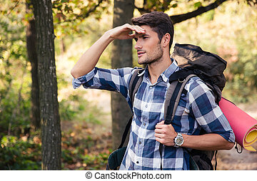 Portrait of a man with marching backpack