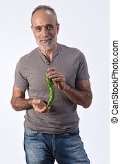 portrait of a man with pepper on white background