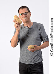 portrait of a man with potato on white background