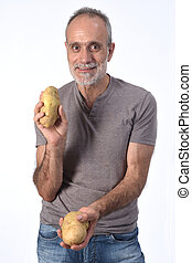 portrait of a man with potatoes on white background