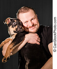 Portrait of a man with puppy dog