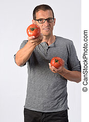 portrait of a man with tomato on white background