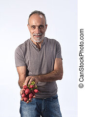 portrait of a man with tomatoes on white background