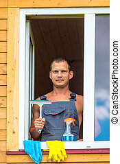portrait of a man with tools for washing windows in the house