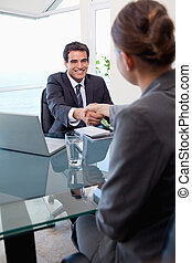 Portrait of a manager interviewing a female applicant in his...