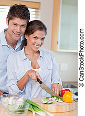 Portrait of a married couple cooking
