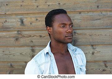Portrait of a masculine black man standing alone