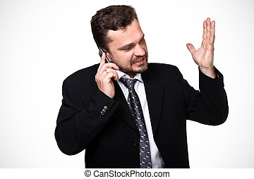 Portrait of a mature business man screaming in his cellphone over white