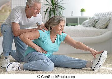 mature couple making exercises