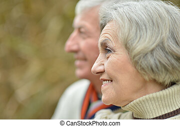 Portrait of a mature couple in the park closeup