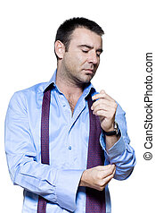 Portrait of a mature man getting dressed in studio isolated...