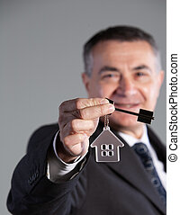 portrait of a mature man with house key
