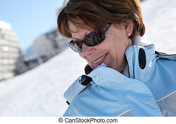 Portrait of a mature woman in ski resort