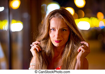Portrait of a mature woman in the city at night