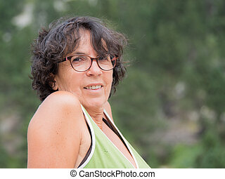portrait of a mature woman with glasses
