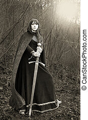 Portrait of a medieval lady with sword (sepia toned)