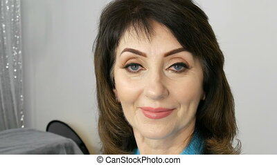Portrait of a middle aged adult woman with beautiful make-up in beauty salon