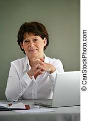 Portrait of a middle-aged woman with her laptop
