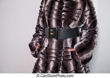 Portrait of a model in a fur coat close-up