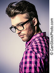 in spectacles - Portrait of a modern young man in...