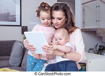 Portrait of a mom with children using a tablet