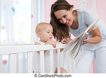 Portrait of a mother and child reading a book together