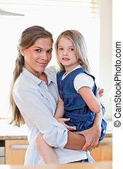 Portrait of a mother and her daughter posing