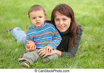 Portrait of a mother and her son outdoors