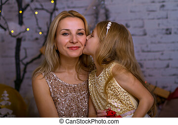 Portrait of a mother with her daughter. Christmas tale