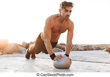 Portrait of a motivated shirtless sportsman