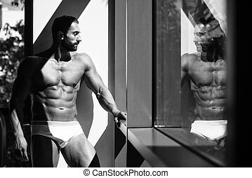 Portrait Of A Muscular Shirtless Model In Underwear