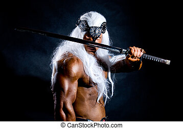 Portrait of a muscular warrior with a sword and a long white hair.Isolated on a black background