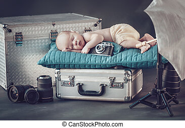 Portrait of a newborn little photographer
