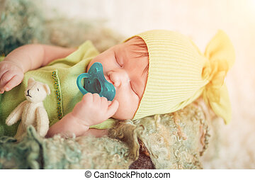 portrait of a newborn with a pacifier