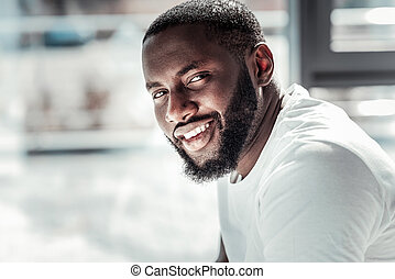 Portrait of a nice Afro American man looking at you