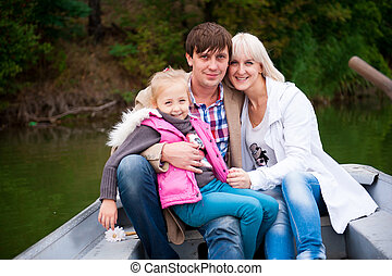 Portrait of a nice family on the boat.