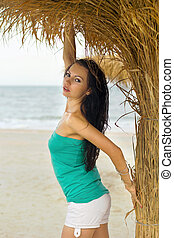 Portrait of a nice young woman on beach