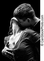 Portrait of a passionate couple, low-key monochrome photo
