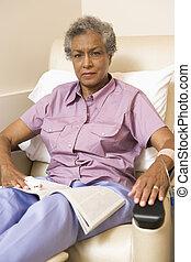 Portrait Of A Patient With A Magazine