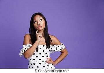 Portrait of a pensive asian woman in dress