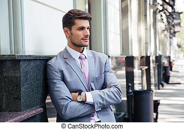 Portrait of a pensive businessman with arms folded
