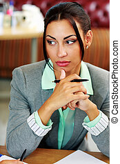 Portrait of a pensive businesswoman looking away in office