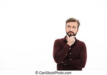 Portrait of a pensive handsome man looking away