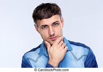 Portrait of a pensive handsome man