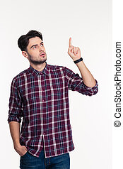 Portrait of a pensive man pointing finger up